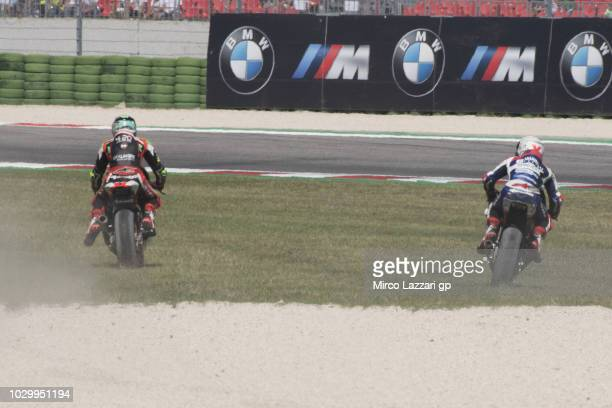 Stefano Manzi of Italy and Forward Racing Team and Romano Fenati of Italy and Marinelli Snipers Team ride out of track during the Moto2 race during...