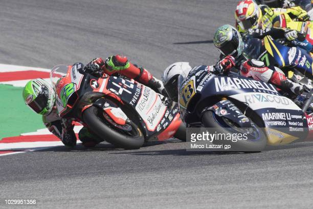 Stefano Manzi of Italy and Forward Racing Team and Romano Fenati of Italy and Marinelli Snipers Team rounds the bend during the Moto2 race during the...