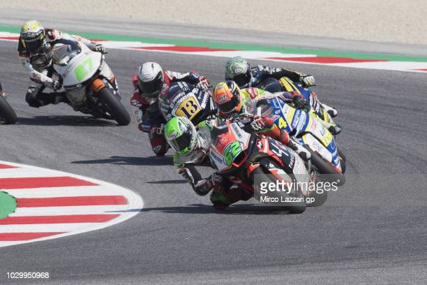Stefano Manzi of Italy and Forward Racing Team leads the field during the Moto2 race during the MotoGP of San Marino Race at Misano World Circuit on...