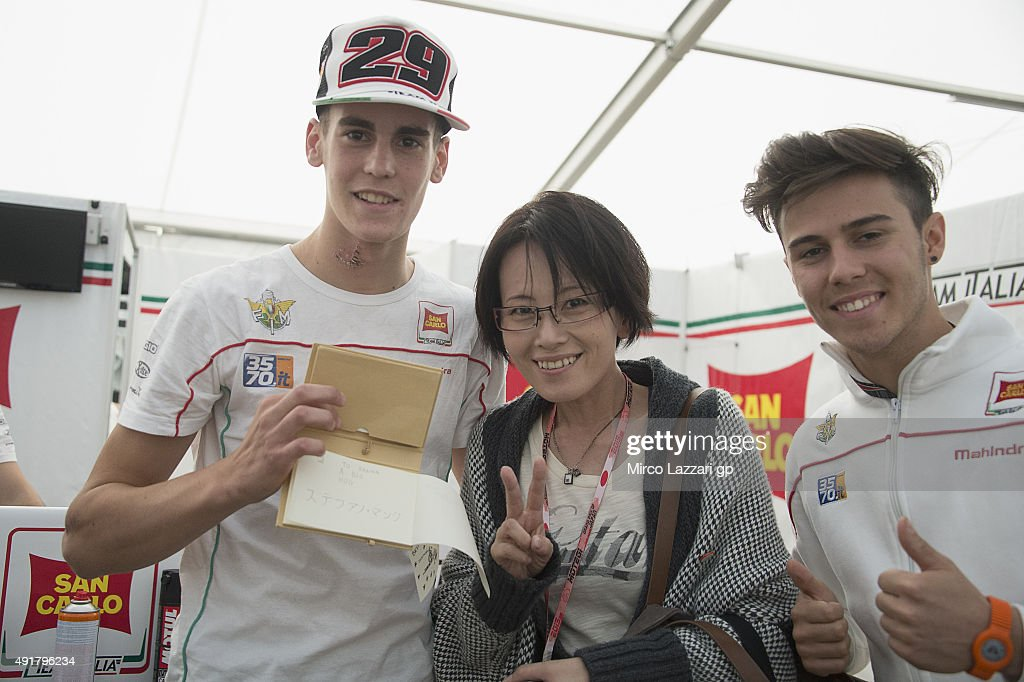 Stefano Manzi of Italy and San Carlo Team Italia, Ranka Fujiwara; of Japan (Illustrator) and Manule Pagliani of Italy and San Carlo Team Italia pose in box during the MotoGP Of Japan - Previews at Twin Ring Motegi on October 8, 2015 in Motegi, Japan.