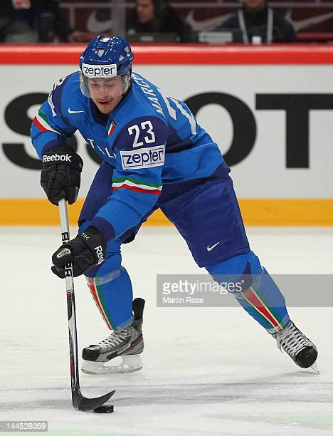 Stefano Marchetti of Italy controls the puck against Russia during the IIHF World Championship group S match between Italy and Russia at Ericsson...