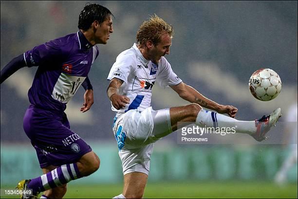 Stefano Marzo of Beerschot AC battles for the ball with Jordan Remacle of KAA Gent during the Jupiler League match between Beerschot AC and AA Gent...