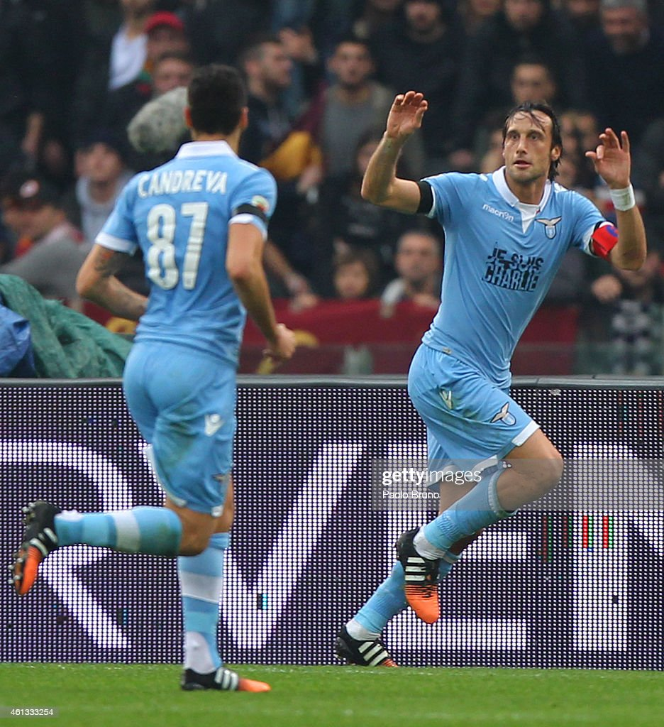Stefano Mauri (L) of SS Lazio celebrates after scoring the opening goal during the Serie A match between AS Roma and SS Lazio at Stadio Olimpico on January 11, 2015 in Rome, Italy.