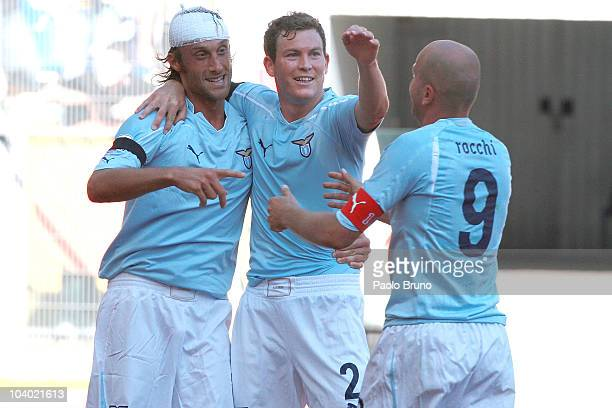 Stefano Mauri of SS Lazio celebrates scoring a goal with team mate Tommaso Rocchi and Stephan Lichtsteiner during the Serie A match between Lazio and...