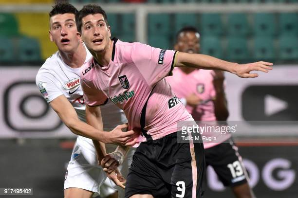 Stefano Moreo of Palermo is challenged by Michele Camporese of Foggia during the Serie B match between US Citta di Palermo and Foggia on February 12...