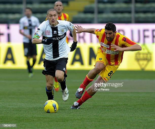 Stefano Morrone of Parma competes with Moris Carrozzieri of Lecce during the Serie A match between Parma FC and US Lecce at Stadio Ennio Tardini on...