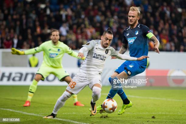 Stefano Napoleoni of Istanbul is tackled by Kevin Vogt of Hoffenheim during the UEFA Europa League group C match between 1899 Hoffenheim and Istanbul...