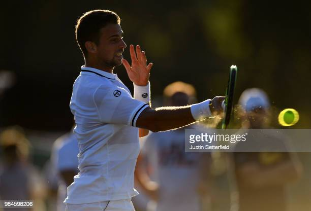 Stefano Napolitano of Italy plays a forehand against Salvatore Caruso of Italy during Wimbledon Championships Qualifying Day 2 at The Bank of England...