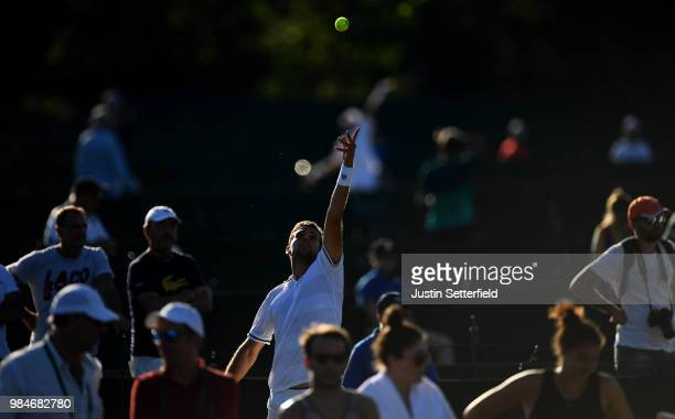 Stefano Napolitano of Italy serves against Salvatore Caruso of Italy during Wimbledon Championships Qualifying Day 2 at The Bank of England Sports...