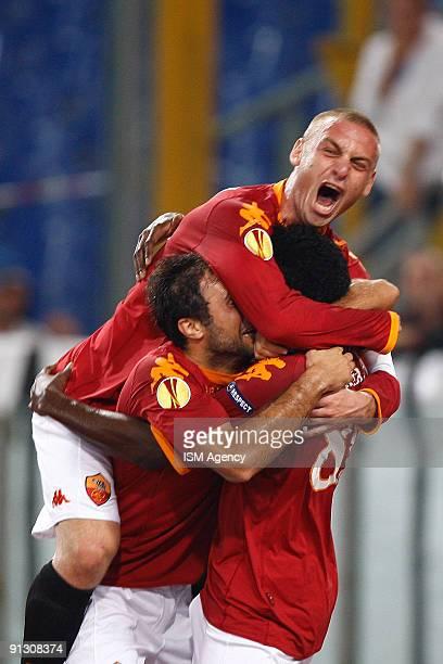 Stefano Okaka , Mirko Vucinic and Daniele De Rossi of AS Roma celebrate the opening goal during the UEFA Europa League Group E match between AS Roma...