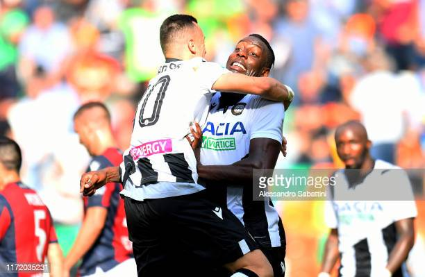 Stefano Okaka of Udinese Calcio celebrates after scoring the opening goal during the Serie A match between Udinese Calcio and Bologna FC at Stadio...