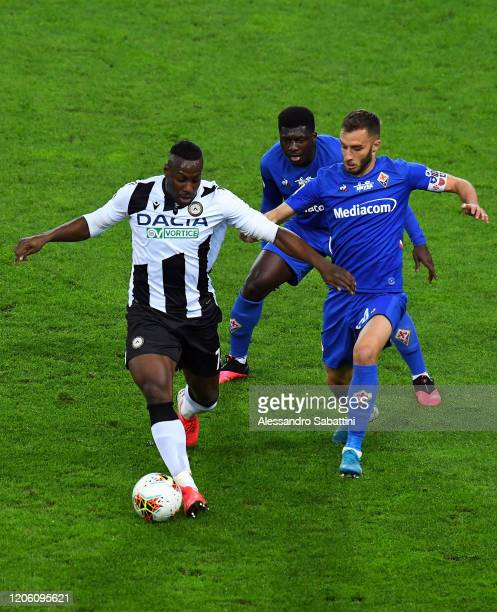 Stefano Okaka of Udinese Calcio competes for the ball with German Pezzella of Fiorentina ACF during the Serie A match between Udinese Calcio and ACF...