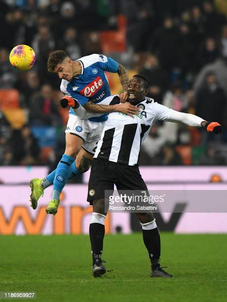 Stefano Okaka of Udinese Calcio competes for the ball with Giovanni Di Lorenzo of SSC Napoli during the Serie A match between Udinese Calcio and SSC...