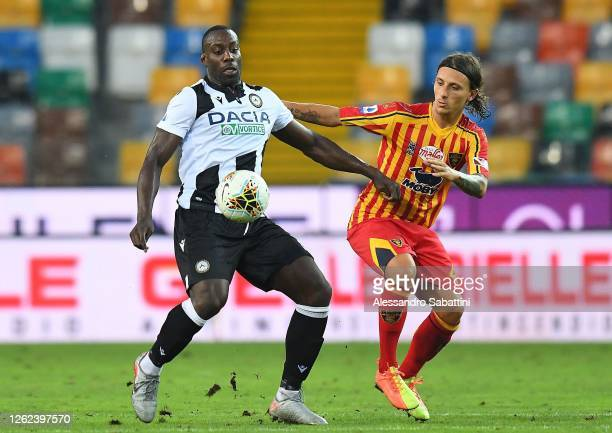 Stefano Okaka of Udinese Calcio competes for the ball with Jacopo Petriccione of US Lecce during the Serie A match between Udinese Calcio and US...