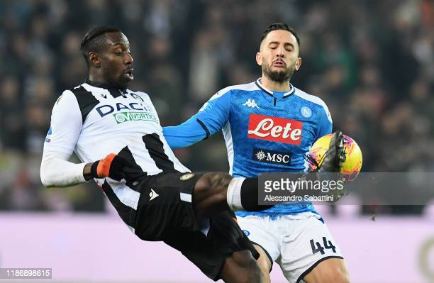 Stefano Okaka of Udinese Calcio competes for the ball with Kostas Manolas of SSC Napoli during the Serie A match between Udinese Calcio and SSC...