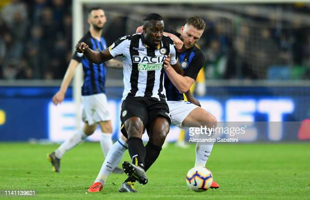 Stefano Okaka of Udinese Calcio competes for the ball with Milan Skriniar of FC Internazionale during the Serie A match between Udinese and FC...