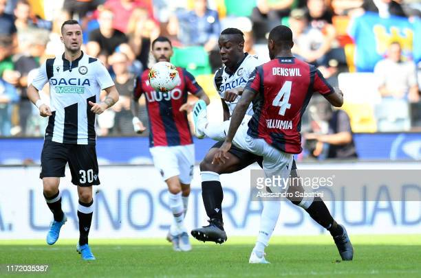 Stefano Okaka of Udinese Calcio competes for the ball with Stefano Denswil of Bologna FC during the Serie A match between Udinese Calcio and Bologna...