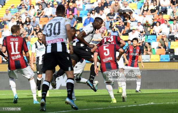 Stefano Okaka of Udinese Calcio scores the opening goal during the Serie A match between Udinese Calcio and Bologna FC at Stadio Friuli on September...