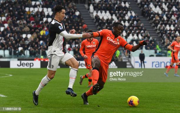 Stefano Okaka of Udinese challenged by Cristiano Ronaldo of Juventus during the Serie A match between Juventus and Udinese Calcio at Allianz Stadium...