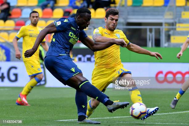 Stefano Okaka of Udinese compete for the ball with NICOL˜ BRIGHENTI of Frosinone during the Serie A match between Frosinone Calcio and Udinese at...