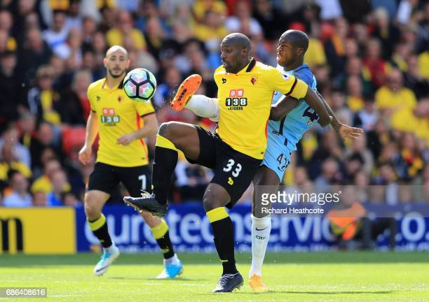 Stefano Okaka of Watfod and Yaya Toure of Manchester City battle for possession during the Premier League match between Watford and Manchester City...