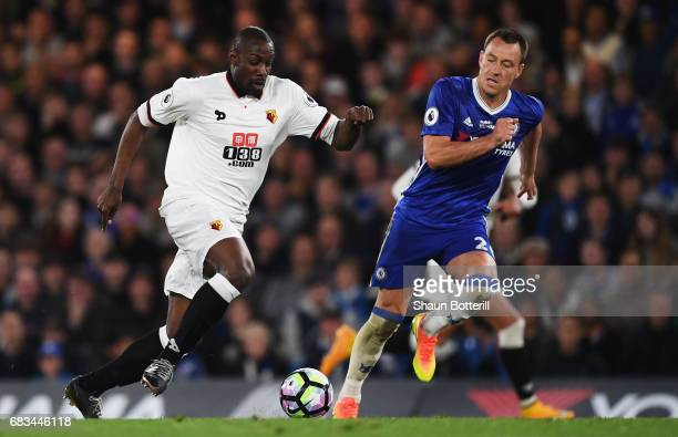 Stefano Okaka of Watford attempts to get past John Terry of Chelsea during the Premier League match between Chelsea and Watford at Stamford Bridge on...