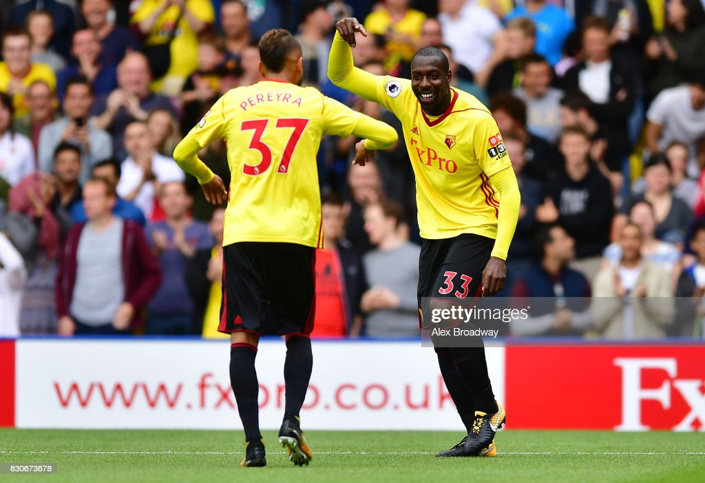 Stefano Okaka of Watford celebrates scoring his sides first goal with Roberto Pereyra of Watford during the Premier League match between Watford and Liverpool at Vicarage Road on August 12, 2017 in Watford, England.