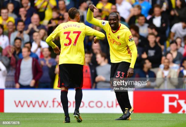 Stefano Okaka of Watford celebrates scoring his sides first goal with Roberto Pereyra of Watford during the Premier League match between Watford and...