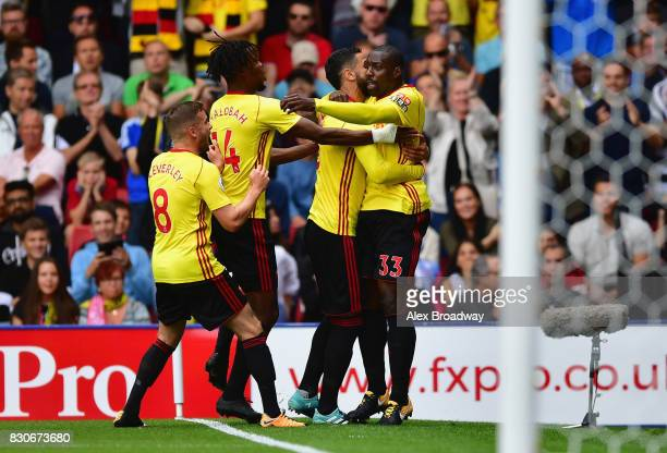 Stefano Okaka of Watford celebrates scoring his sides first goal with his Watford team mates during the Premier League match between Watford and...