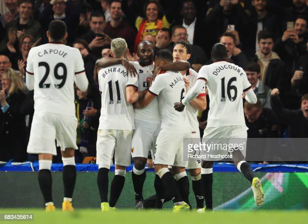 Stefano Okaka of Watford celebrates scoring his sides third goal with his Watford team mates during the Premier League match between Chelsea and...