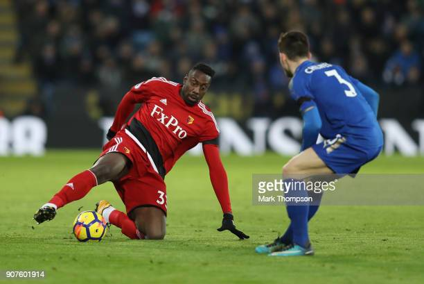 Stefano Okaka of Watford controls the ball while under pressure from Ben Chilwell of Leicester City during the Premier League match between Leicester...