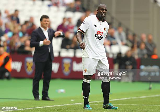Stefano Okaka of Watford holds his leg after a challenge during the Premier League match between West Ham United and Watford at Olympic Stadium on...
