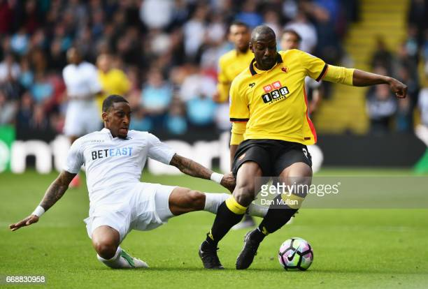 Stefano Okaka of Watford is fouled by Leroy Fer of Swansea City during the Premier League match between Watford and Swansea City at Vicarage Road on...