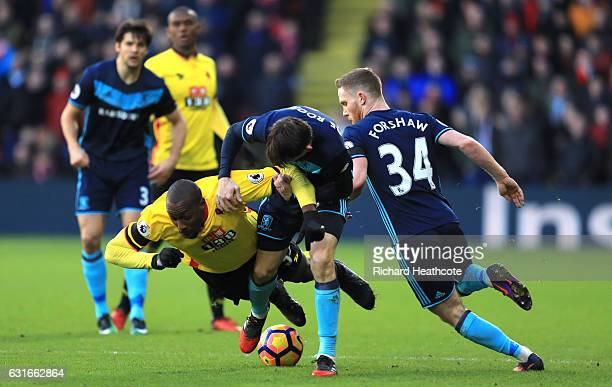 Stefano Okaka of Watford is fouled by Marten de Roon of Middlesbrough during the Premier League match between Watford and Middlesbrough at Vicarage...