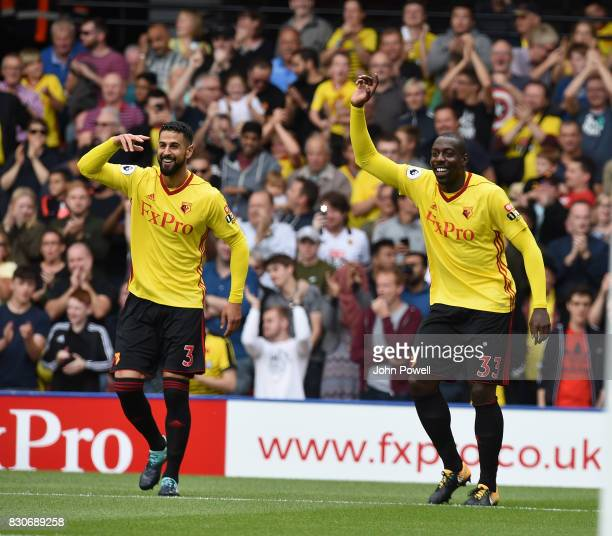 Stefano Okaka of Watford Scores the opener and celebrates during the Premier League match between Watford and Liverpool at Vicarage Road on August 12...