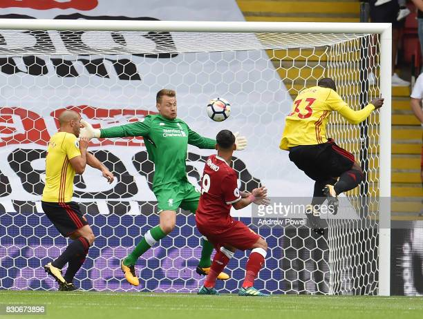 Stefano Okaka of Watford Scores the opener during the Premier League match between Watford and Liverpool at Vicarage Road on August 12 2017 in...