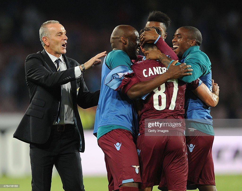 Stefano Pioli and Players of Lazio celebrate the victory after the Serie A match between SSC Napoli and SS Lazio at Stadio San Paolo on May 31, 2015 in Naples, Italy.