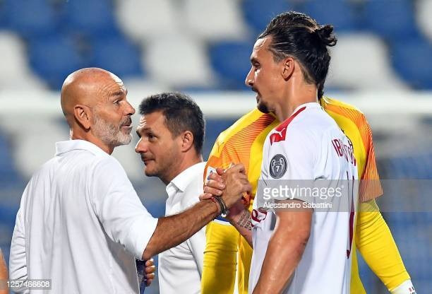 Stefano Pioli head coach of AC Milan and Zlatan Ibrahimovic of AC Milan celebrate the victory after the Serie A match between US Sassuolo and AC...