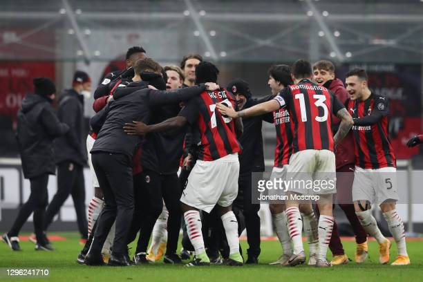 Stefano Pioli Head coach of AC milan celebrates with his players follwing the penalty shoot out win in the Coppa Italia match between AC Milan and...