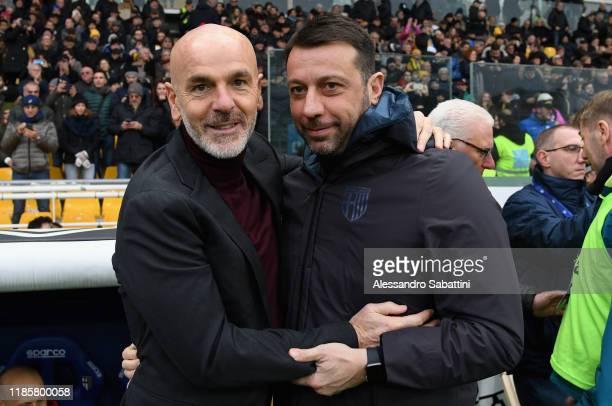 Stefano Pioli head coach of AC Milan embraces Roberto D'Aversa head coach of Parma Calcio during the Serie A match between Parma Calcio and AC Milan...