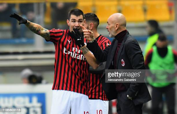 Stefano Pioli head coach of AC Milan issues instructions to Alessio Romagnoli of AC Milan during the Serie A match between Parma Calcio and AC Milan...