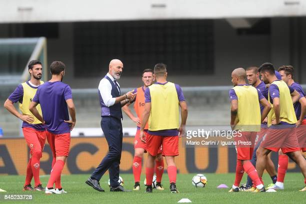 Stefano Pioli head coach of ACF Fiorentina talks to his players during the warm up before the beginning of the Serie A match between Hellas Verona FC...