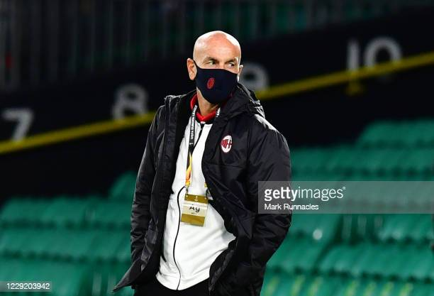 Stefano Pioli, manager of AC Milan track side as he watches his players on the Celtic Park pitch for a player walk round ahead of the UEFA Europa...