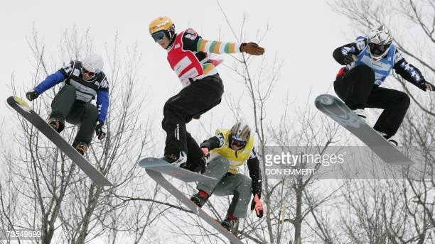 Stefano Pozzolini of Italy, Stian Sivertzen of Norway, Lukas Gruener of Austria and Ruben Arnold of Switzerland fly through the air in the FIS World...