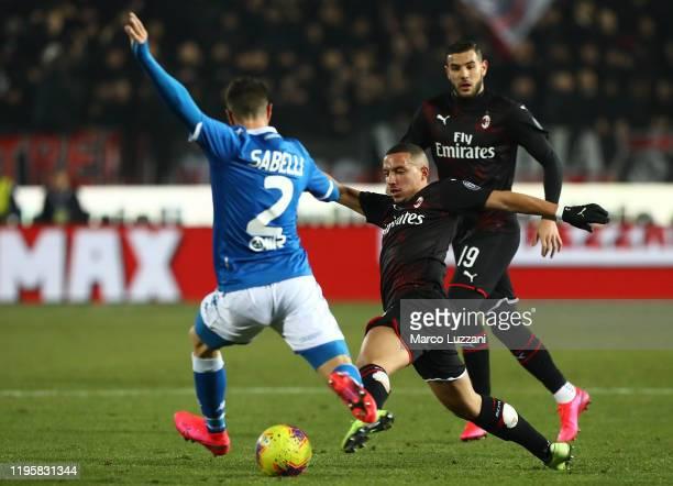 Stefano Sabelli of AC Milan competes for the ball with Ernesto Torregrossa of Brescia Calcio during the Serie A match between Brescia Calcio and AC...