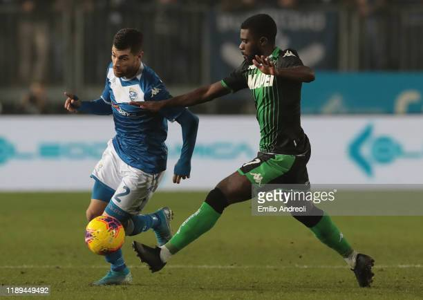 Stefano Sabelli of Brescia Calcio is challenged by Jeremie Boga of US Sassuolo during the Serie A match between Brescia Calcio and US Sassuolo at...