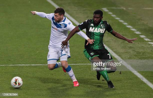 Stefano Sabelli of Brescia Calcio is challenged by Jeremie Boga of US Sassuolo during the Serie A match between US Sassuolo and Brescia Calcio at...