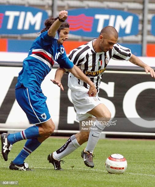 Stefano Sacchetti of Sampdoria clashes with Marco Di Vaio of Juventus after scoring a goal during the Serie A match between Juventus and Sampdoria...
