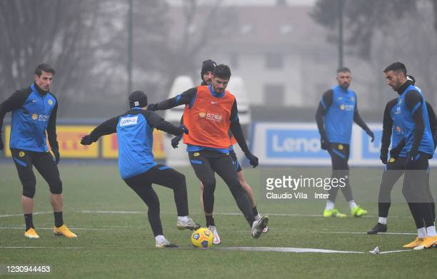 Stefano Sensi and Andrea Ranocchia of FC Internazionale in action during a training session at Appiano Gentile on February 3, 2021 in Como, Italy.