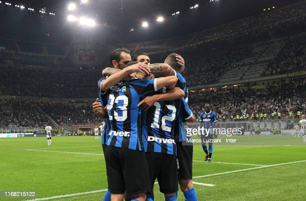 Stefano Sensi of FC Internazionale celebrates with team-mates after scoring the opening goal during the Serie A match between FC Internazionale and...